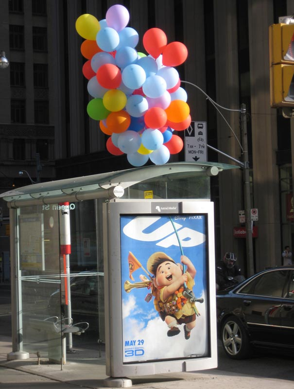 bus-stop-ads-up-balloons